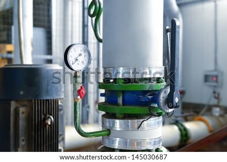 industrial barometer in boiler room - stock photo