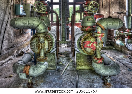 Industrial boiler room in a derelict factory,HDR - stock photo