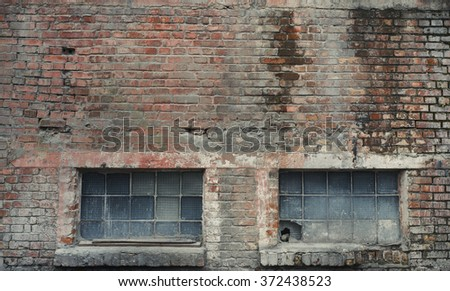 Industrial brick building wall with windows. Vintage effect.  - stock photo