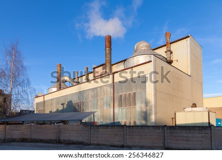 Industrial building and blue sky - stock photo