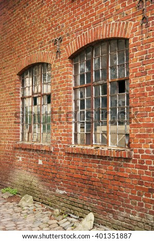Industrial building brick wall with two windows - stock photo