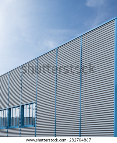 Industrial building of corrugated iron facade - stock photo