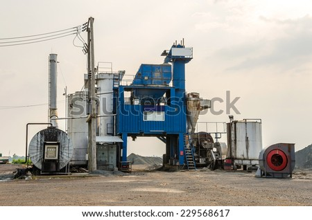 industrial cement processing plant. - stock photo