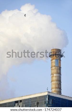 Industrial chimney releasing a huge amount of smoke - stock photo