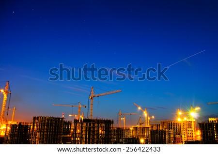 Industrial construction night city - stock photo