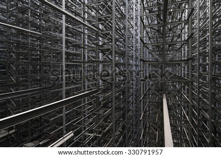 Industrial construction of many metal grey girders on modern plant - stock photo