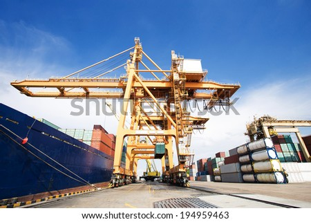 Industrial Container Cargo freight ship with working crane bridge in shipyard - stock photo