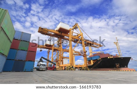 Industrial Container Cargo freight ship with working crane bridge in shipyard with forklift - stock photo