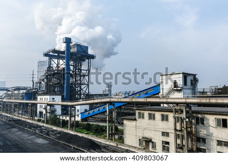Industrial cooling tower of smoke pollution in the steel mill - stock photo