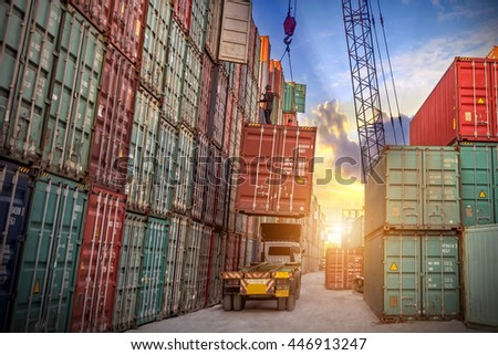 Industrial crane loading Containers in a Cargo freight ship to truck for Logistic Import Export concept - stock photo