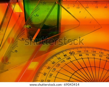 Industrial Design - triangles, scales, protractor with green plastic part. - stock photo