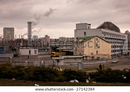 Industrial district with plant pipes (polluting air) - stock photo