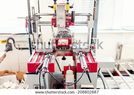 industrial drilling machinery with automatic controls. factory tools for metal or plastic drilling - stock photo