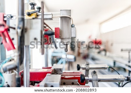 industrial drilling machinery with automatic process. Factory milling and drilling equipment and machines  - stock photo