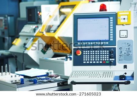industrial equipment of cnc milling machine center in tool manufacture workshop - stock photo