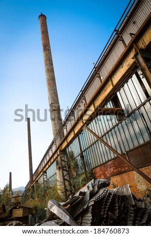 Industrial exterior with chimney - stock photo