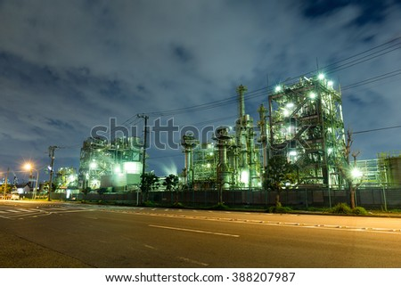 Industrial factory at night - stock photo