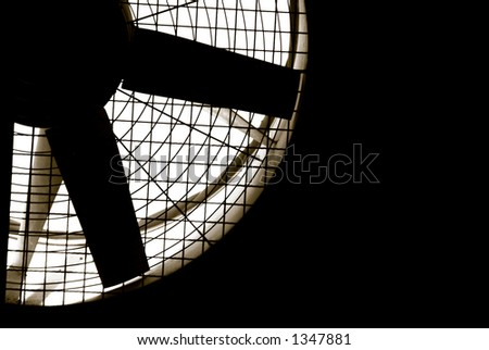 Industrial fan turbine behind a metal grate, with copy space - stock photo