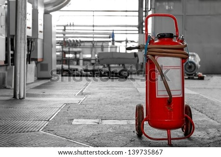 Industrial fire extinguisher in a building - stock photo