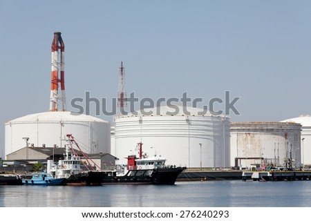 Industrial fuel storage tanks at oil refinery - stock photo