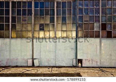 Industrial garage doors with windows - stock photo