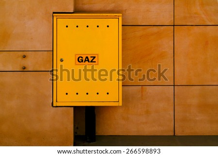 Industrial gas meter yellow box and pipes - stock photo