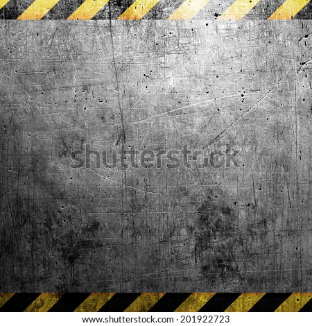 Industrial grungy steel plate with black and yellow strip - stock photo