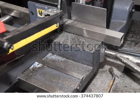 industrial hacksaw in metal workshop - stock photo