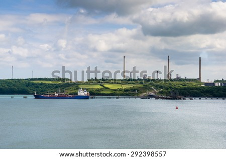 Industrial Harbour with a Tanker and Chimneys in Background - stock photo