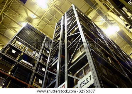 Industrial High-Rise Product Warehousing. - stock photo