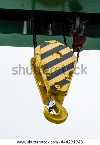 Industrial Hook on a Pulley and cables - stock photo