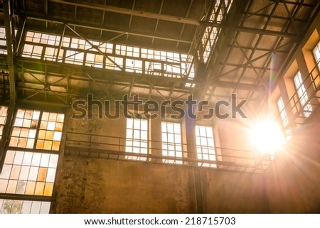 Industrial interior with br light from the windows - stock photo