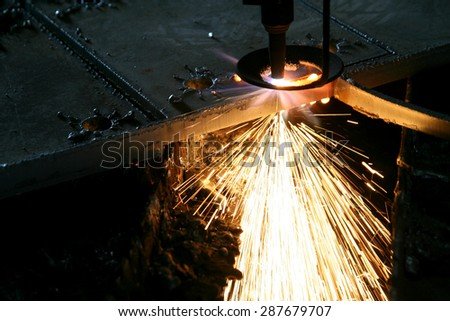 Industrial Laser cutting metal with sparks - stock photo