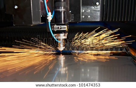 Industrial Laser cutting processing manufacture technology of flat sheet metal steel material with sparks - stock photo