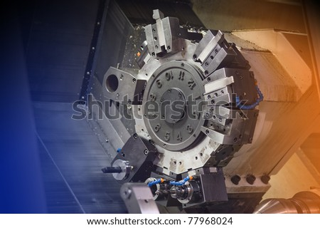 Industrial lathe in a hi tech machine shop - stock photo
