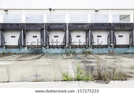 Industrial Loading Dock, detail of a factory in the industrial area, loading and unloading of material - stock photo