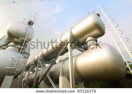 Industrial machines, pipes, tubes, machinery and steam turbine in a power plant. - stock photo