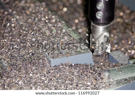 industrial metal machining cutting process of blank detail by milling cutter - stock photo
