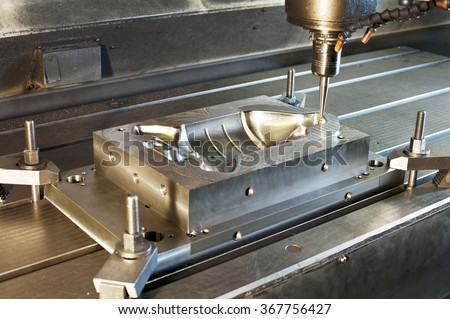 Industrial metal mold/ blank milling. Metalworking and mechanical engineering. CNC technology. Milling, lathe and drilling industry. - stock photo