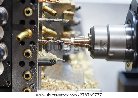 industrial metal work machining cutting process of blank detail by drilling - stock photo