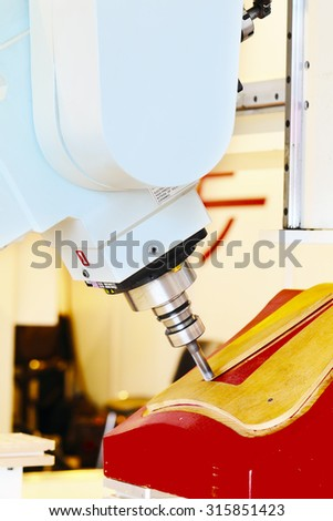 Industrial milling CNC machine tool with replaceable end mill - stock photo