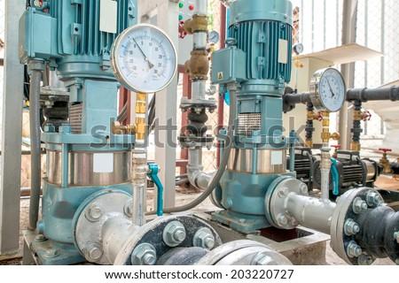 Industrial motor pump with Pressure Gauges in factory - stock photo