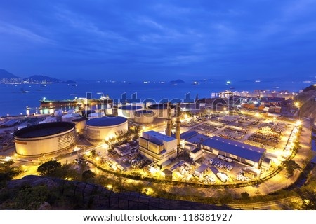 Industrial oil tanks at night - stock photo