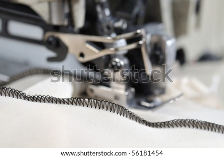 Industrial overlocker sewing machine - a series of TAILOR related images. - stock photo