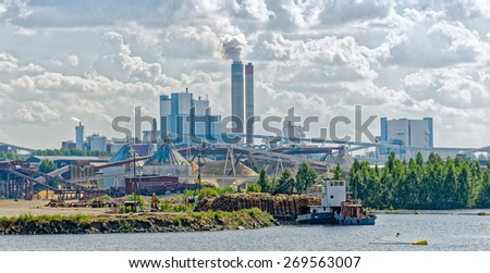 Industrial Paper Mill along a riverbank - stock photo