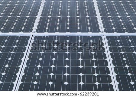 industrial photovoltaic solar panels with blue sky - stock photo