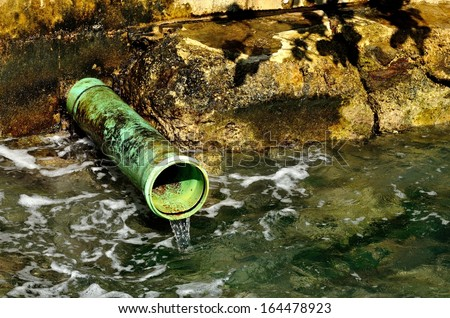 Industrial Pipe Dumping Waste Water Into The Ocean - stock photo