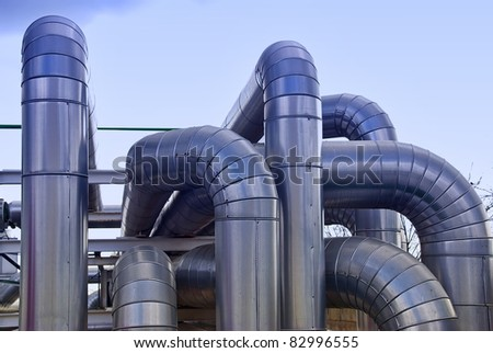 Industrial pipelines in a power station facility - stock photo