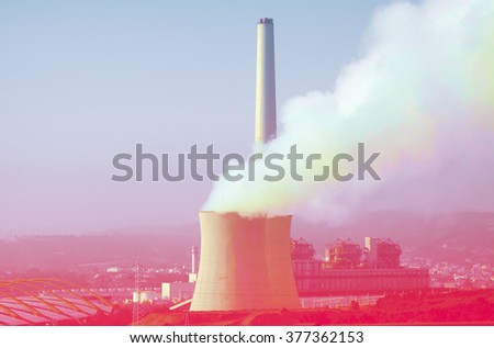 Industrial plant with chimney and cooling towers in  summer day - stock photo