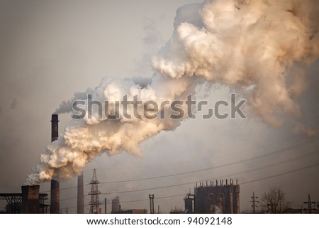 Industrial plant with yellow smoke. Air pollution concept - stock photo